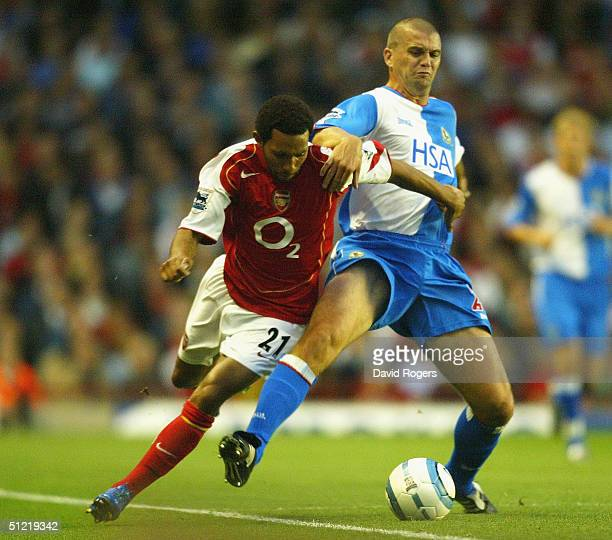Jermaine Pennant of Arsenal is tackled by Dominic Matteo during the Barclays Premiership match between Arsenal and Blackburn Rovers at Highbury on...