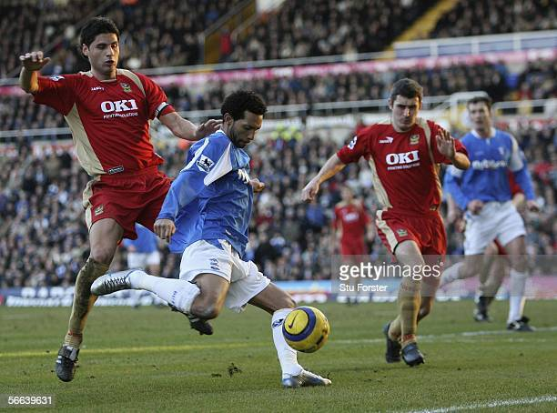 Jermaine Pennant of Birmingham gets in a shot at goal despite the attentions of defenders Dejan Stefanovic and Andy Griffin of Portsmouth during the...