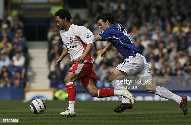 Jermaine Pennant of Birmingham moves away from Simon Davies of Everton during the Barclays Premiership match between Everton and Birmingham City at...