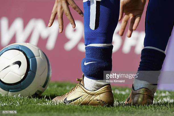 Jermaine Pennant of Brimingham City with a secureity tag attached to his left ankle takes a corner during the Barclays Premiership match between...