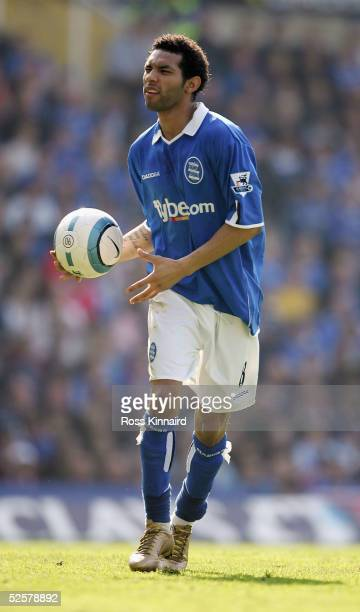 Jermaine Pennant of Brimingham City with his secureity tag attached to his left ankle takes a corner during the Barclays Premiership match between...