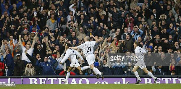 Jermaine Pennant of Leeeds is congratulated by Dominic Matteo after scoring during the FA Barclaycard Premiership match between Leeds United and...