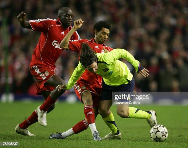 Jermaine Pennant of Liverpool battles for the ball with Lionel Messi of Barcelona during the UEFA Champions League round of sixteen second leg match...