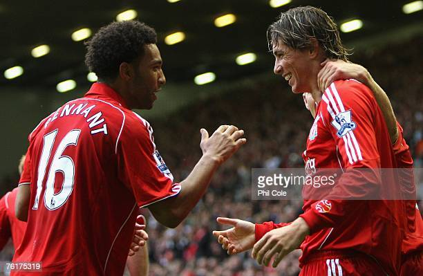 Jermaine Pennant of Liverpool congratulates team mate Fernando Torres after he scored the opening goal during the Barclays Premier League match...