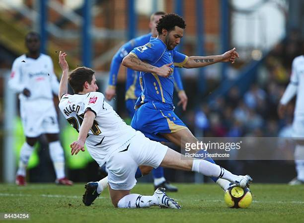 Jermaine Pennant of Portsmouth is tackled by Joe Allen of Swansea during the FA Cup sponsored by EON 4th Round match between Portsmouth and Swansea...