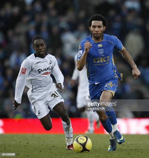 Jermaine Pennant of Portsmouth , on loan from Liverpool, comes under pressure from Nathan Dyer of Swansea City during their FA Cup Fourth round...