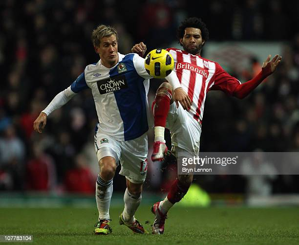 Jermaine Pennant of Stoke City battles with Morten GamstPedersen of Blackburn Rovers during the Barclays Premier League match between Blackburn and...