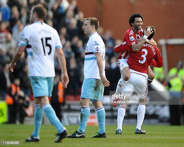 Jermaine Pennant of Stoke City congratulates scorer Danny Higginbotham during the FA Cup sponsored by EON 6th Round match between Stoke City and West...