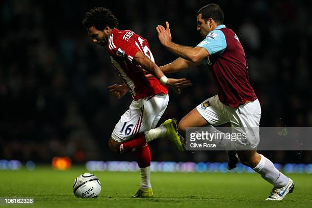 Jermaine Pennant of Stoke City is challenged by Tal Ben Haim of West Ham United during the Carling Cup fourth round match between West Ham United and...
