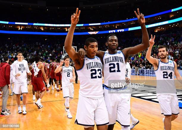 Jermaine Samuels and Dhamir CosbyRoundtree of the Villanova Wildcats walk off the court after defeating the Alabama Crimson Tide 8158 in the second...