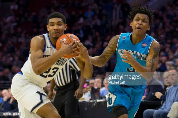 Jermaine Samuels of the Villanova Wildcats and James Akinjo of the Georgetown Hoyas fight for possession of the ball in the second half at the Wells...