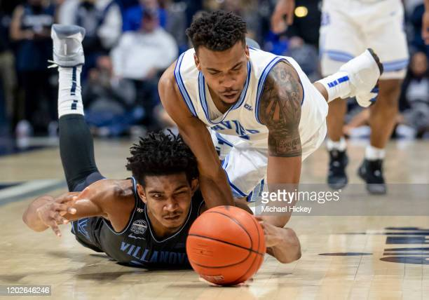 Jermaine Samuels of the Villanova Wildcats and Paul Scruggs of the Xavier Musketeers battle for the ball during the second half at Cintas Center on...