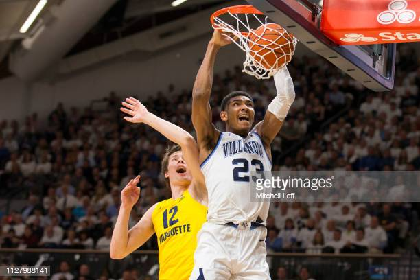 Jermaine Samuels of the Villanova Wildcats dunks the ball past Matt Heldt of the Marquette Golden Eagles in the first half at Finneran Pavilion on...