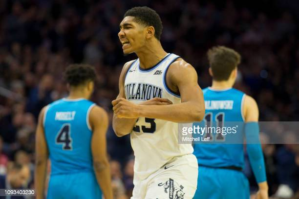 Jermaine Samuels of the Villanova Wildcats reacts in front of Jagan Mosely and Greg Malinowski of the Georgetown Hoyas in the second half at the...