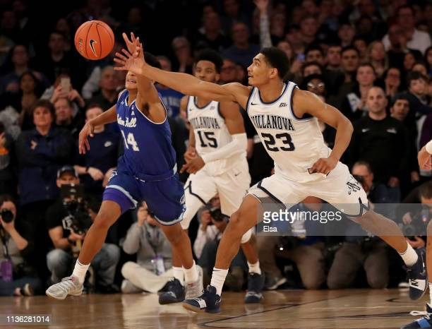 Jermaine Samuels of the Villanova Wildcats swats the ball away from Jared Rhoden of the Seton Hall Pirates in the final seconds of the game during...