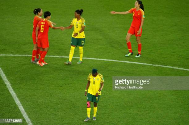Jermaine Seoposenwe of South Africa shakes hands with Peng Han of China during the 2019 FIFA Women's World Cup France group B match between South...
