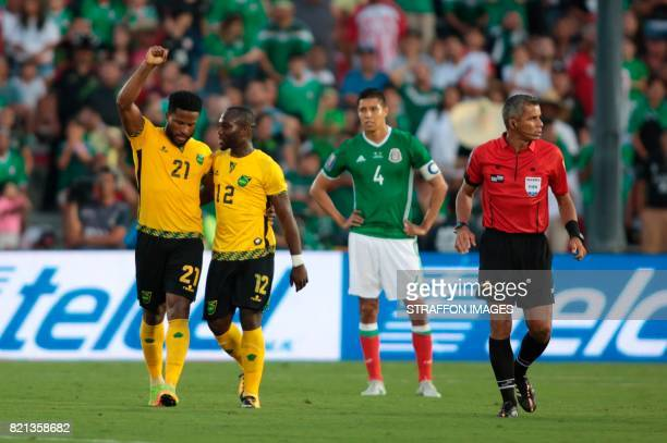 Jermaine Taylor and Michael Binns of Jamaica celebrate the goal scored by Kemar Lawrence during a match between Mexico and Jamaica as part of...