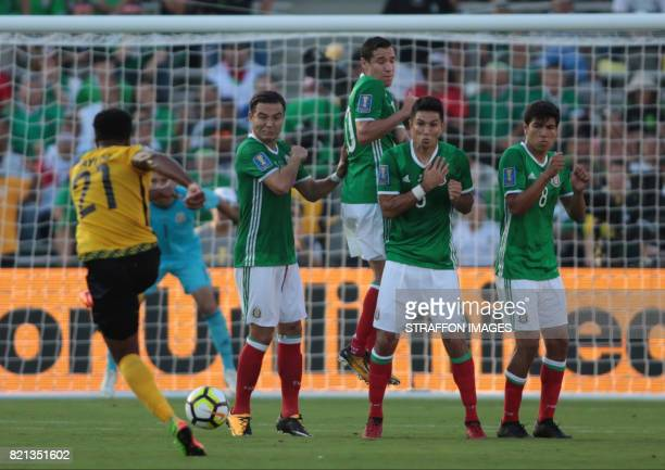 Jermaine Taylor of Jamaica takes a free kick during a match between Mexico and Jamaica as part of CONCACAF Gold Cup Semifinal at Rose Bowl Stadium on...