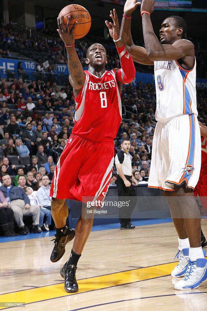 Jermaine Taylor #8 of the Houston Rockets shoots over Sege Ibaka #9 of the Oklahoma City Thunder on November 17, 2010 at the Oklahoma City Arena in Oklahoma City, Oklahoma.