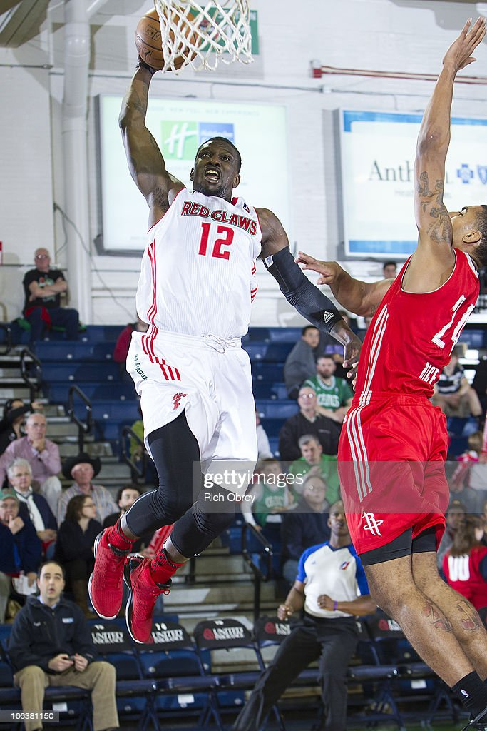 Jermaine Taylor #12 of the Maine Red Claws dunks against Glen Rice Jr. #24 of the Rio Grande Valley Vipers during the NBA D-League playoff game on Thursday, April 11, 2013 at the Portland Expo in Portland, Maine.