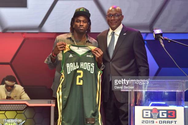 Jermaine Taylor poses with BIG3 Commissioner Clyde Drexler after being drafted at by the Ball Hogs in the second round during the BIG3 Draft at the...
