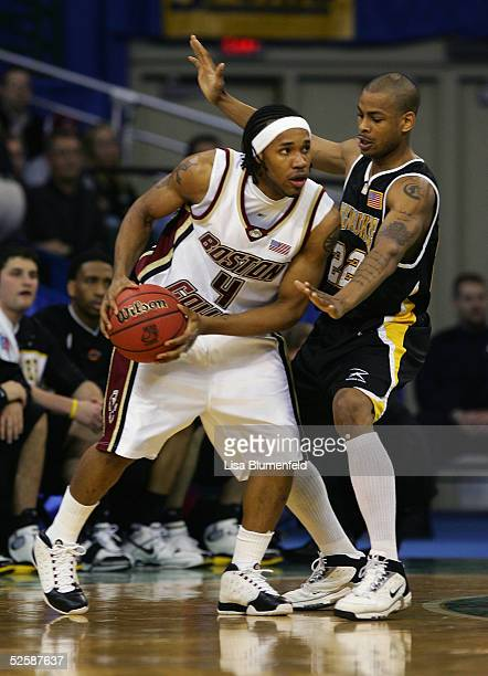 Jermaine Watson of the Boston College Eagles looks to pass around Ed McCants of the WisconsinMilwaukee Panthers during the second round of the 2005...