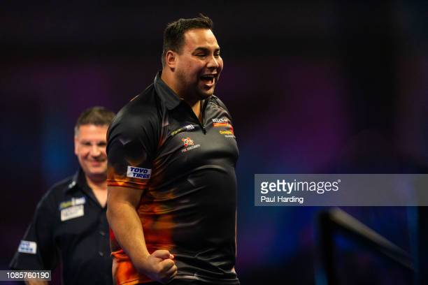 Jermaine Wattimena celebrates during his third round match against Gary Anderson during Day 10 of the 2019 William Hill World Darts Championship at...