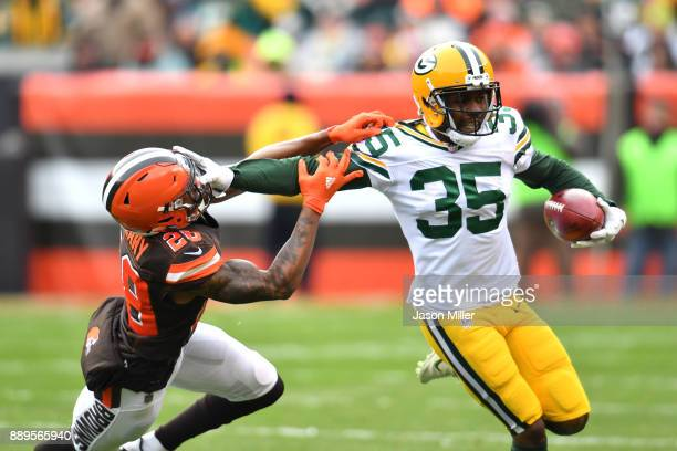 Jermaine Whitehead of the Green Bay Packers stiff arms Darius Hillary of the Cleveland Browns in the first quarter at FirstEnergy Stadium on December...