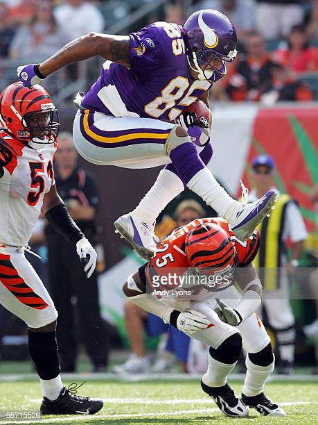 Jermaine Wiggins of the Minnesota Vikings jumps over Keiwan Ratliff of the Cincinnati Bengals during the NFL game at Paul Brown Stadium on September...