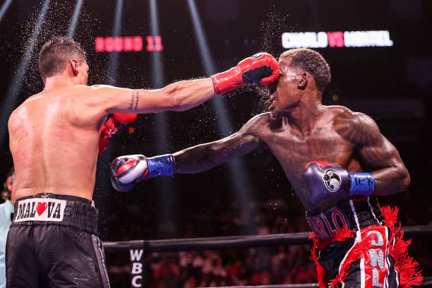 Jermall Charlo and Juan Macias Montiel exchange punches during their WBC middleweight title fight at Toyota Center on June 19, 2021 in Houston, Texas.