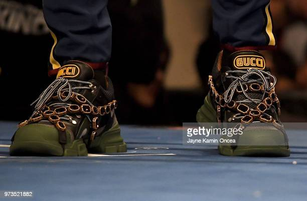 Jermall Charlo twin brother of Jermell Charlo wears Gucci shoes while standing in the ring before the start of the WBC Super Welterweight Title at...