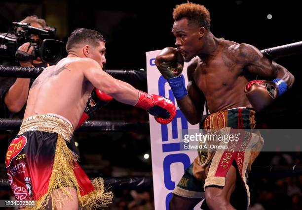 Jermell Charlo and Brian Castano exchange punches during their Super Welterweight fight at AT&T Center on July 17, 2021 in San Antonio, Texas. The...
