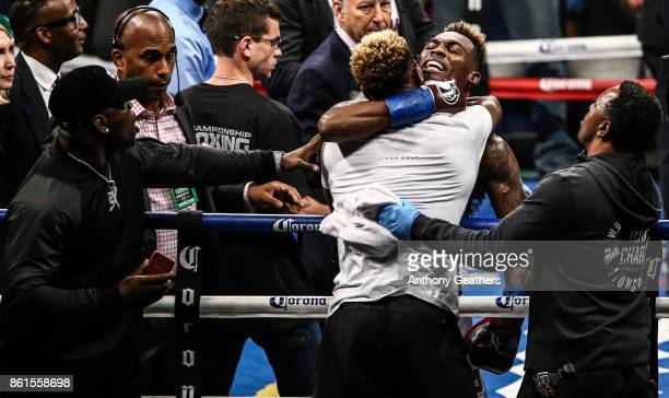 Jermell Charlo celebrates his first round knockout against Erickson Lubin with his twin brother Jermall Charlo after their WBC Junior Middleweight...