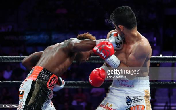 Jermell Charlo connects with a punch that sends Jorge Cota to the canvas during the third round of their super welterweight fight at the Mandalay Bay...