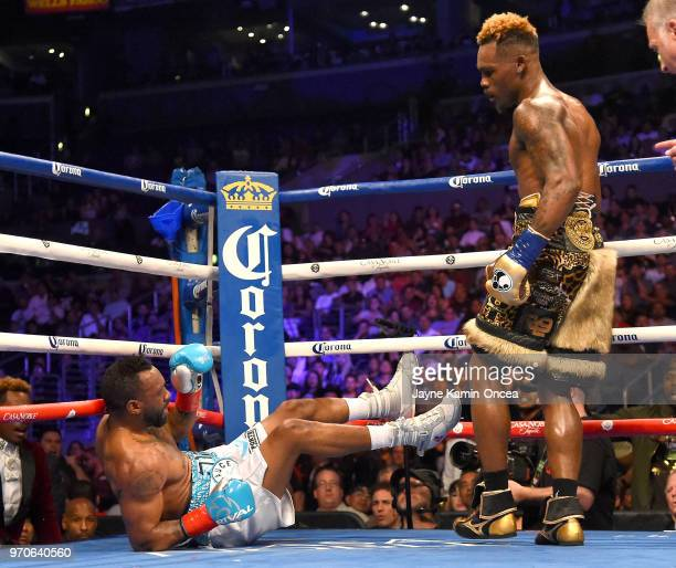 Jermell Charlo knocks down Austin Trout in their WBC Super Welterweight Title bout at Staples Center on June 9 2018 in Los Angeles California Charlo...
