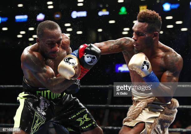 Jermell Charlo punches Charles Hatley during their WBC junior middleweight title bout at the Barclays Center on April 22 2017 in New York City
