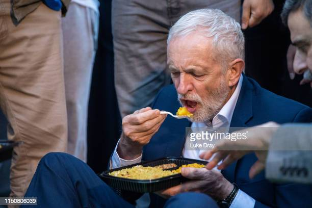 Jermery Corbyn eats during the street Iftar at Finsbury Park on May 21 2019 in London England Two years on from the Finsbury Park Mosque terrorist...