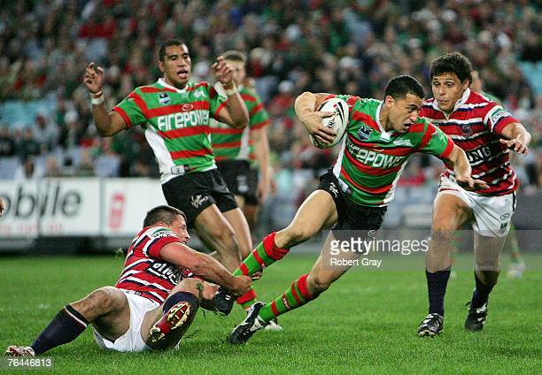 Jermey Smith of the Rabbitohs is tackled by the Roosters during the round 25 NRL match between the South Sydney Rabbitohs and the Sydney Roosters at...