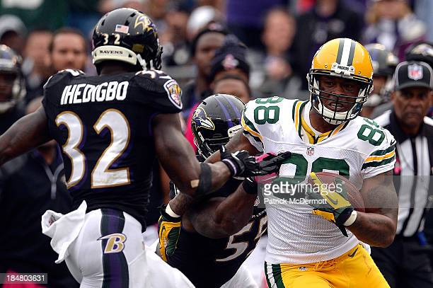 Jermichael Finley of the Green Bay Packers is tackled by Terrell Suggs of the Baltimore Ravens during a game at MT Bank Stadium on October 13 2013 in...