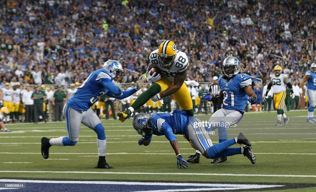 Jermichael Finley #88 of the Green Bay Packers scores on a 20 yard pass from Aaron Rogers #12 during the second quarter of the game against the Detroit Lions at Ford Field on November 18, 2012 in Detroit, Michigan.