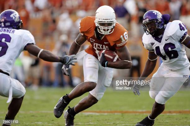 Jermichael Finley of the Texas Longhorns runs between the defense of linebacker David Hawthorne and safety Brian Bonner of the TCU Horned Frogs on...