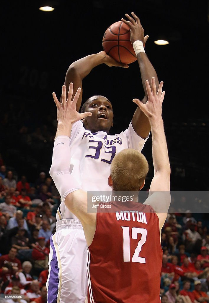 Jernard Jarreau #33 of the Washington Huskies shoots over Brock Motum #12 of the Washington State Cougars in the first half during the first round of the Pac 12 Tournament at the MGM Grand Garden Arena on March 13, 2013 in Las Vegas, Nevada.