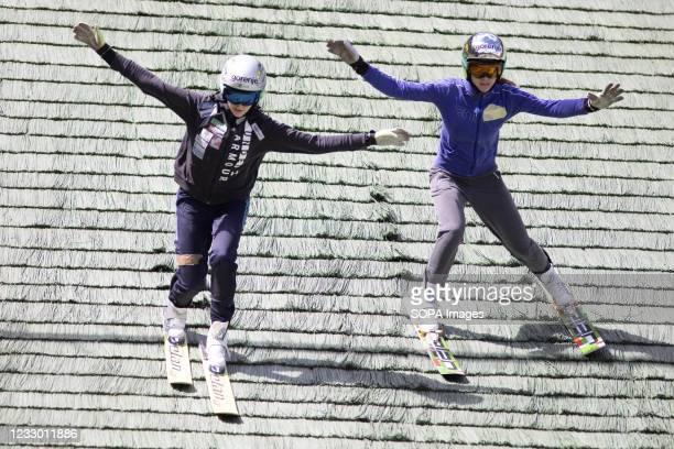 Jerneja Brecl and Ursa Bogataj practice with short skis during the training. Slovenias ladies ski jumping team train ahead of the new ski jumping...