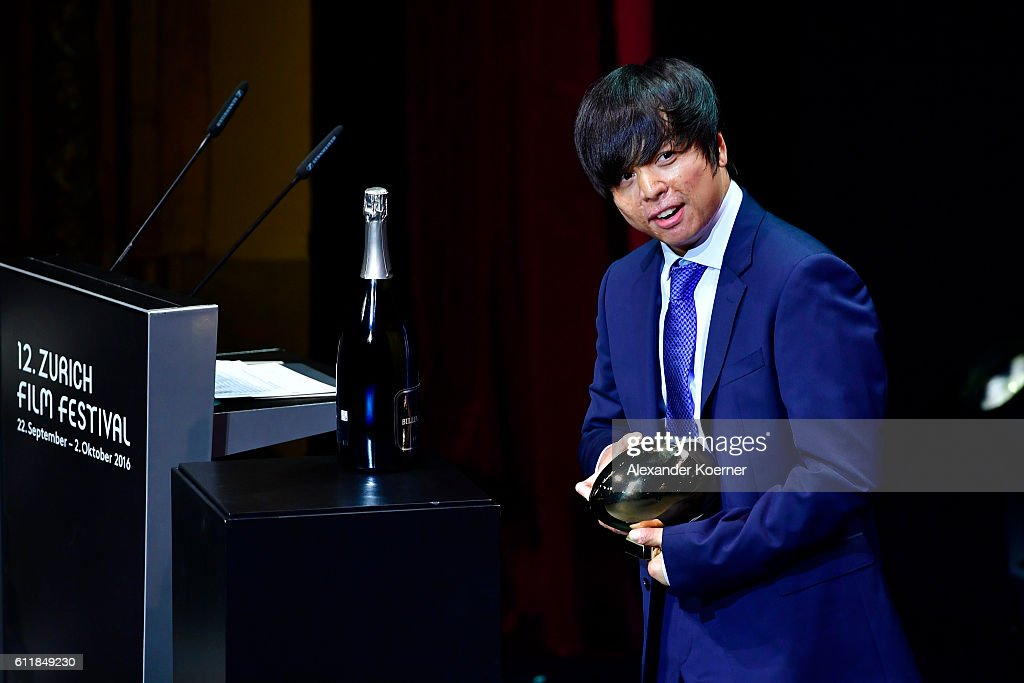 Jero Yun poses with the award for international documentary for his movie 'Mrs. B., A North Korean Woman' on stage during the Award Night Ceremony during the 12th Zurich Film Festival on October 1, 2016 in Zurich, Switzerland. The Zurich Film Festival 2016 will take place from September 22 until October 2.