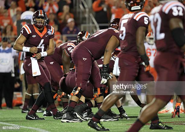 Jerod Evans of the Virginia Tech Hokies calls a play during the ACC Championship against the Clemson Tigers on December 3 2016 in Orlando Florida