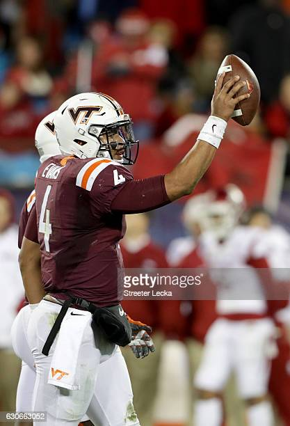 Jerod Evans of the Virginia Tech Hokies celebrates after a defeating the Arkansas Razorbacks 3524 in the Belk Bowl at Bank of America Stadium on...