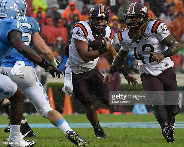 Jerod Evans of the Virginia Tech Hokies runs against the UNC Tar Heels at Kenan Stadium on October 8 2016 in Chapel Hill North Carolina
