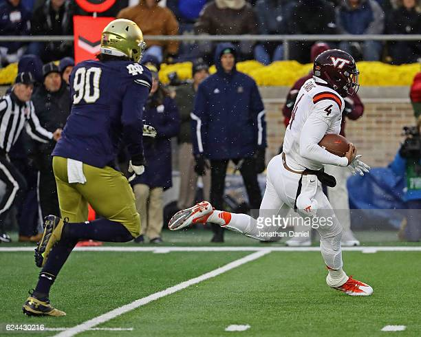 Jerod Evans of the Virginia Tech Hokies uns for touchdown chased by Isaac Rochell of the Notre Dame Fighting Irish at Notre Dame Stadium on November...