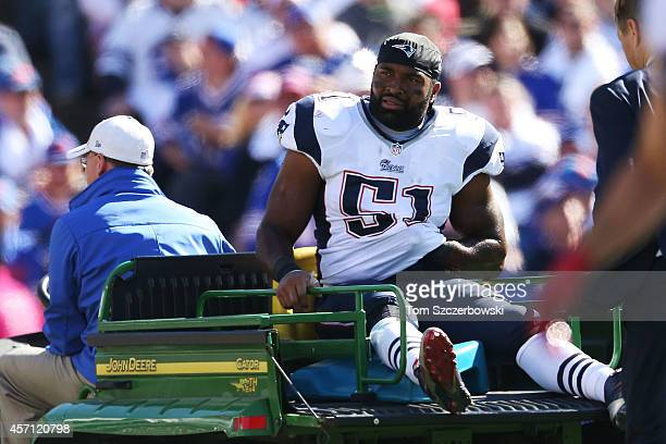 Jerod Mayo of the New England Patriots is carted off the field after an injury against the Buffalo Bills during the first half at Ralph Wilson...