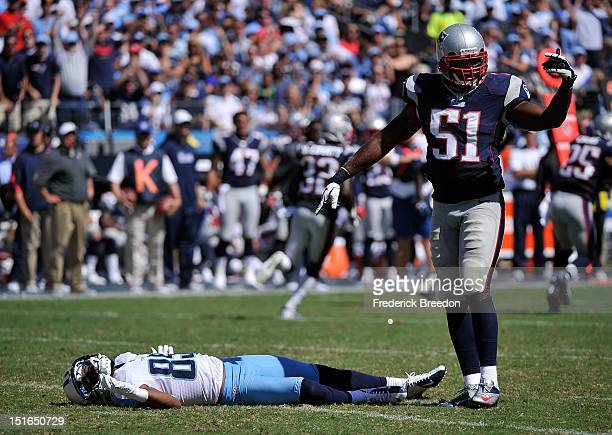 Jerod Mayo of the New England Patriots signals for the medical staff to come examine Nate Washington of the Tennessee Titans during their season...